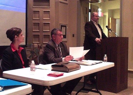 Legislators Lori Cornell (Jamestown) and Vince Horrigan (Bemus Point) listen as Legislator Larry Barmore (Gerry) talks during the Prendergast Library's Critical Discussion involving the County Home on Jan. 8, 2013.