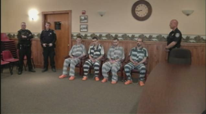 The four suspects in town of Carroll court, after being charged with the double homicide of two residents in the Town of Carroll on April 17, 2013. (Image from WIVB TV)